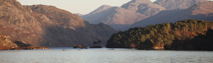 A photo looking east towards the islands of Loch Morar.